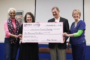 Homes & Land makes 'pink' donation to American Cancer Society